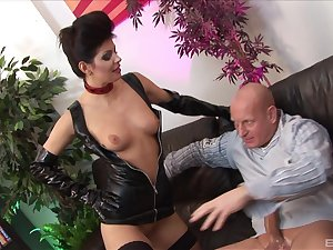 Lucy Love wears black latex and fucks with her pulling friend