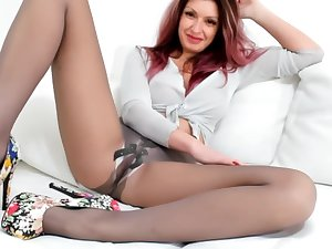 Amazing whorish lady in nylon pantyhose is eager to pet herself with plaything