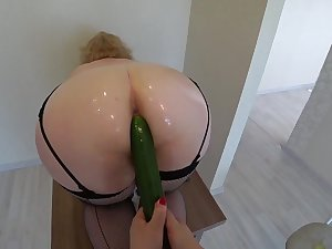 Mature milf with big tits with an increment of a racy ass phase fucked with a cucumber on the table, lesbians.