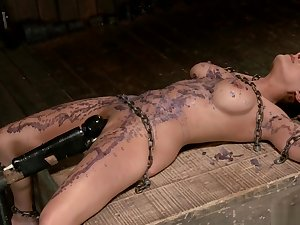 Chained slut is waxed and tormented