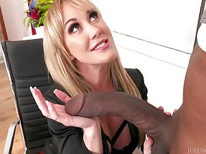 Experienced, blonde milf, Brandi Love is giving a blowjob near Jules Jordan beofre riding his load of shit