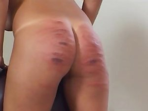 Slut enjoys having her ass spanked hard by a dominant blonde
